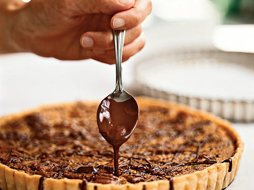 Pecan pie is often purely sweet with no undertones, but the bourbon, molasses, and chocolate in this beautiful centerpiece dessert all add complexity of flavor. It's also somewhat thinner than a pie, meaning you get more buttery, flaky crust in each bite.