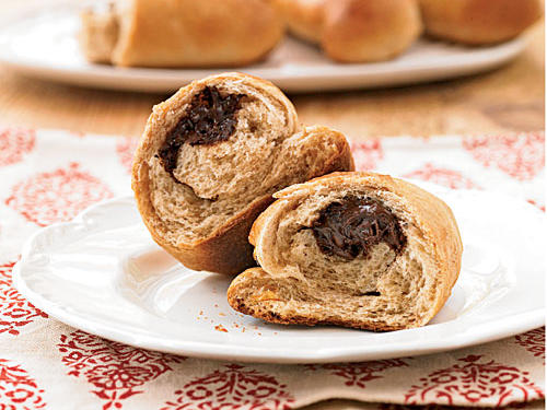 """I remember eating chocolate-filled croissants around the holidays as a child,"" said reader Christina Erickson. ""I decided to create something that has the best of all worlds: easy to make, whole wheat, soft dough, and, most importantly, chocolate. I like to chill the chocolate before shaping the buns so it doesn't melt while I'm working with it."""