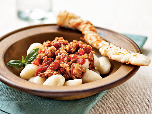 Ragù (a deeply flavored, very meaty sauce) and gnocchi (dense but fluffy potato dumplings) are both great hearty fare for cold weather. Putting them together in this dish makes the ultimate soul-warming meal, but using turkey instead of the traditional pork or beef reduces saturated fat: This recipe has 5.5 grams per serving, and just 317 calories. No gnocchi on hand? Just make the ragù and serve like Sloppy Joes.