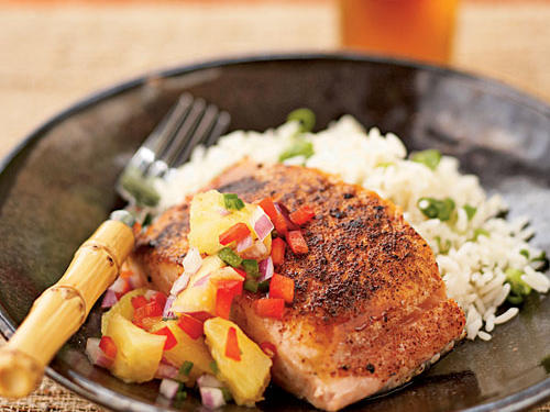 A chili-powder rub and high-temperature cooking give the top of the salmon fillets a crisp browned texture, almost like Cajun blackening, while the chunky sweet-sour-hot relish brings in tropical flavor. If you chop the pineapple a bit finer, the relish also makes an excellent salsa for dipping tortilla chips.