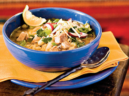 A hominy-based stew, posole is ideal comfort food. With its mild flavor, the hominy makes a great foil for the hearty pork, spicy chiles, radishes, green onions, and limes.