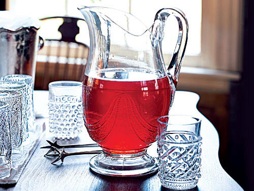 Serve an adults-only tea, flavored with orange liqueur, for neighborhood happy hour gatherings.