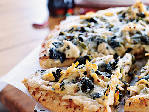 To be a great use of Thanksgiving leftovers, a recipe needs to reuse more than one left over item. This dish does just that, topping a pizza with turkey and greens (you can use creamed spinach, collards, or really just about any green side). You could even go really crazy and spread leftover cranberry sauce on the crust, though the Alfredo in this recipe works very nicely. If it's not Thanksgiving, leftover chicken works just as well as turkey.