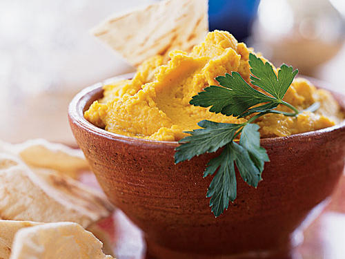 If you keep canned chickpeas on hand (and you should), hummus is an easy anytime snack, side, or sandwich spread. This spiced version can stand in for lentil dal on an Indian menu, or it can pair with Mediterranean-flavored lamb.