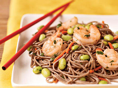 Soba noodles, made from buckwheat, are a great item to keep in the pantry for easy meals: They cook quickly and contribute complex carbs and filling fiber to any dish, Asian or otherwise. The addition of edamame and shrimp makes this recipe a nutritional powerhouse, providing more than half of the protein and almost a third of the iron you need in a day with only 418 calories and 1.3 grams of saturated fat per serving.