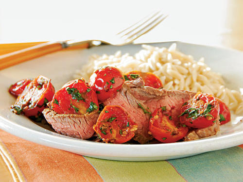Lean, thin flank steak is best when cooked briefly at high heat, which makes it a great choice for quick-and-easy recipes like this one. The sweet, spicy, and fresh-tasting tomato topping that cooks in four minutes doesn't hurt either. Start the topping as soon as you take the meat out of the oven; the steak will be perfectly rested and juicy when everything's ready to serve.