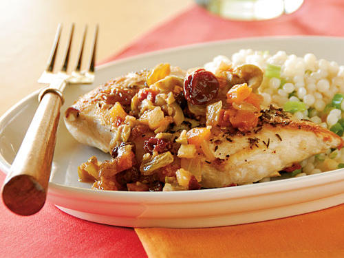 Opposites attract in this recipe: The concentrated sweetness of dried fruit and the briny sharpness of olives combine seamlessly to give plain chicken breasts huge flavor. Regular or Israeli couscous are great, authentically Moroccan sides, but any grain would be tasty―bulgur, barley, rice pilaf, even grits or polenta.