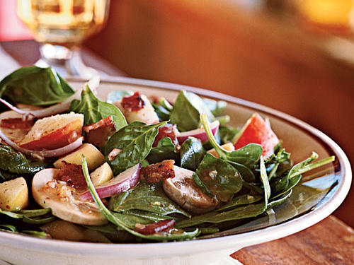 Opposites do attract: Smoky, salty bacon and crisp, fresh spinach are paired in salads all the time. What makes this recipe unique is its maple syrup-based dressing, which adds richness in addition to maple flavor, and tart apple pieces, which add another layer of taste. Add a baked potato for an easy dinner meal.
