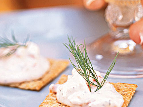A classic smoked salmon dip or spread is something every hostess should have in her back pocket. Make this dip ahead, and serve it on whole-wheat crackers or toasted baguette with a pretty sprig of dill. Save the leftovers to smear on a toasted bagel half over coffee the next morning.