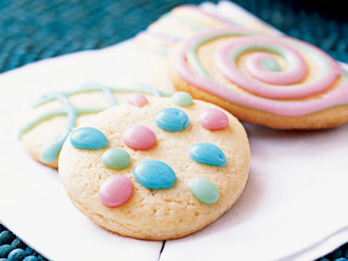 "These festive cookies are loosely based on the Greek Easter specialty koulourakia. Use egg-shaped cookie cutters to create these Easter ""eggs"" (we ordered ours from H.O. Foose Tinsmithing Co.). Enlist kids to decorate these simple cookies."