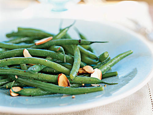The classic side dish gets a fresh makeover with the addition of a sherry-Dijon mustard vinaigrette. Haricots verts are the traditional bean, but regular green beans work just as well.