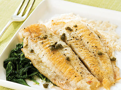 The classic preparation for veal or chicken gets an elegant update here. Delicate flounder cooks with a crisp crust in three minutes, then is doused with a piquant lemon-caper sauce. Rice and briefly cooked spinach complete the meal.