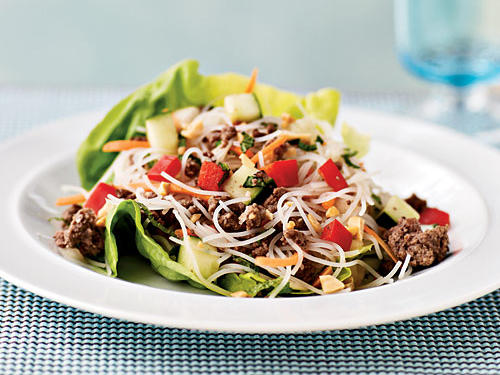 This Thai-style salad of ground beef, vegetables, and rice noodles is flavored with lime, mint, and soy, then topped with peanuts for crunch. Serving on lettuce leaves makes for a fun, kid-friendly presentation―roll them up and eat with your hands.