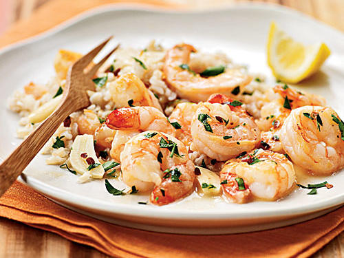 Lemon and seafood are a natural pair, but this dish brings the combination to the fore by sautéing lemon slices with the shrimp for cooked-in citrus flavor. Crushed red pepper provides a bit of spice, but if you like it hotter, chop and add some fresh or dried chili pepper―poblano, Serrano, or your own favorite.