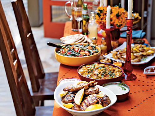 Bright colors like orange, blue, and red bring an exotic feel to any table.
