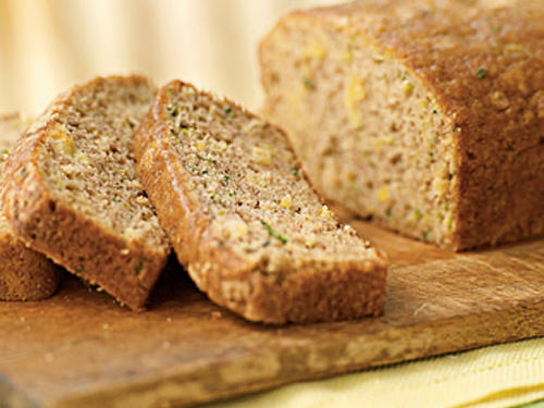 Warm cinnamon and crushed pineapple turn ordinary mellow zucchini bread into a distinctive sweet snack or dessert.