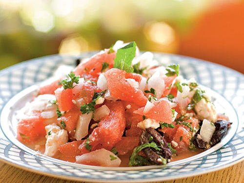Instead of offering watermelon wedges at your next cookout, branch out with this sweet and savory watermelon salad featuring cubed watermelon, red onion, kalamata olives, mint, and feta cheese. Even with all the added flavorful ingredients, it still weighs in at only 46 calories per serving.