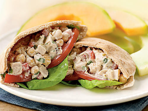 There's a lot to these simple-sounding sandwiches, but that doesn't mean they take more than 10 minutes to make. Chickpeas, bell pepper, olives, onion, and cilantro join chicken in a tangy lemon-cumin-yogurt dressing. This is a great recipe to make meatless, as well: Just replace the chicken with cubes of firm tofu.