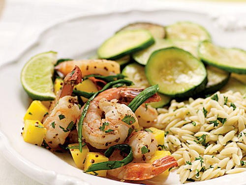 This recipe delivers on its title: shrimp sautéed with mustard and hot sauce. Mango and cilantro give a little moderation to those potent flavors for a complete dish, ready in under five minutes and with less than 200 calories a serving. Pair with pasta or rice and just about any vegetable for an easy meal.