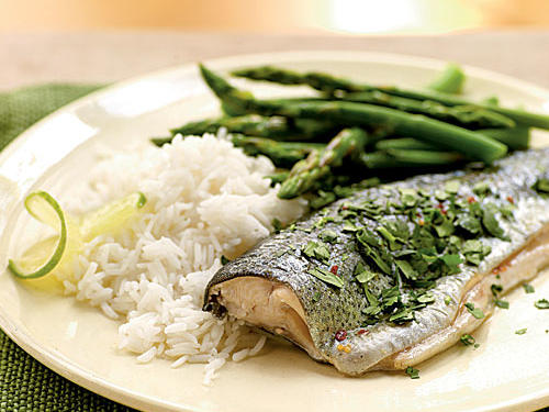 Just six ingredients and 10 minutes build big flavor in this recipe. Tangy lime and pungent fish sauce play off the natural sweetness of trout, with a nice kick of red-pepper heat. Serve this dish―rich in protein, calcium, and healthy fats―alongside a whole grain like brown rice or barley and your favorite vegetable for a nutritionally complete and flavorful meal.