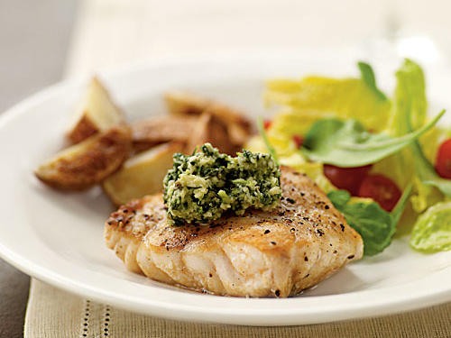 With its meaty texture and taste, grouper is a good fish to convert non-fish-eaters, especially when simply grilled. The garlicky pistou, a French twist on pesto, brightens the fish's flavor and adds dimension. Many different sides can complement this dish: Try oven fries or a baked potato, a simple green salad with oil and vinegar, or pasta dressed with extra pistou.