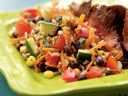 A plethora of summer vegetables gives this healthy brown rice salad fresh flavor.