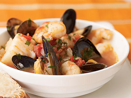 Shellfish are a boon to superfast recipes: They cook quickly and require minimal prep work. Hardly any seasoning at all interferes with the pure seafood flavors of this dish―onion, garlic, tomatoes, parsley, and red pepper are all that's needed―but its briny taste will transport you to the northern California coast. Don't forget the French bread for dipping!