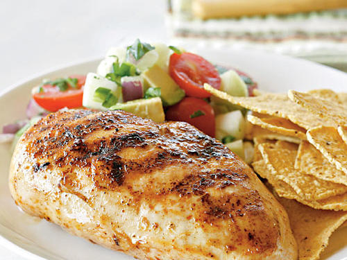 Baked tortilla chips make a crunchy companion for this simple chicken supper. Try the avocado, tomato, and cucumber salsa another night on grilled fish or shrimp.