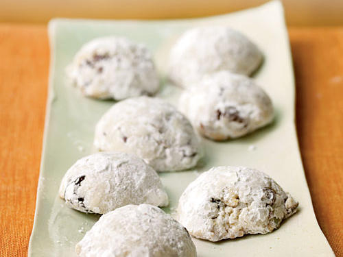 These delicate, crumbly cookies are stuffed with tartly sweet dried cherries and nuttily sweet pistachios, then coated with purely sweet powdered sugar.