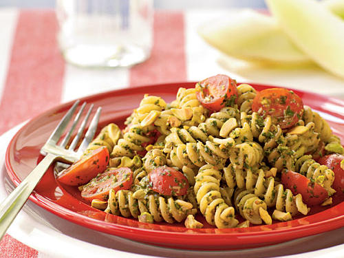 Toss cooked fusilli pasta with a homemade pistachio pesto for a refreshing twist on traditional pine nut-based pesto dishes.  Add cooked chicken for a heartier dish.