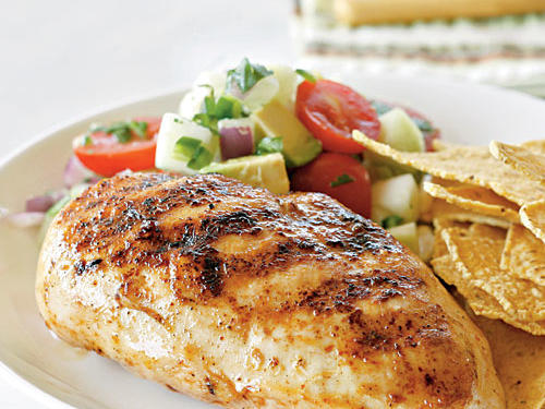Talk about an easy dinner: Chicken, salt, chipotle chile powder, grill. The easy salsa adds fresh flavor and cools the chicken's heat a bit, but it's not strictly necessary―the chicken can pair with almost any combination of fresh veggies lightly cooked or raw in a salad. A chicken breast plus a large helping of salsa has only 243 calories, so you can even indulge in dessert without guilt afterward.
