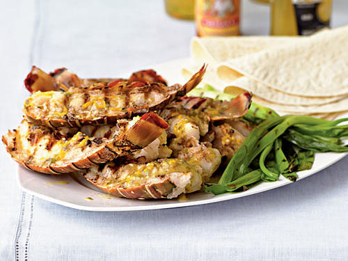 A simple citrus sauce perfectly complements the lobster tails in this easy yet elegant entrée. Serve with warmed tortillas, lightly grilled green onions, and cold Mexican beer for a satisfying meal that's just right for romantic evenings at home or entertaining friends.