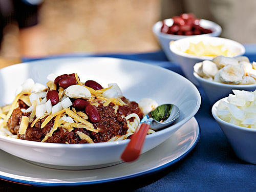 "Cincinnatians do their chili differently: Instead of five-alarm heat, warm spices like cinnamon and allspice and a bit of brown sugar give the chili an altogether different, yet delicious, profile. Instead of a cornbread side, the chili comes over cooked spaghetti—truly a meal in a bowl. And instead of Mexican-inspired toppers like sour cream, avocado, and cilantro, locals swear by shredded Cheddar cheese, chopped white onion, and beans. Reviewer smd1212 said our version stacks up to Ohio's token dish: ""Very tasty, and seemed pretty accurate flavor-wise compared to our local Cincinnati chili place."""