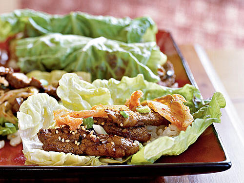 Based on the classic Korean barbecue dish bulgogi, this recipe offers savory-sweet-garlicky beef wrapped in lettuce leave with rice and kimchi.