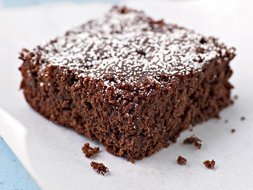 This rich dessert uses less fat than traditional brownies by substituting water and cherry preserves in place of some of the oil. The combination of unsweetened cocoa and semisweet chips makes for a rich, dark flavor.
