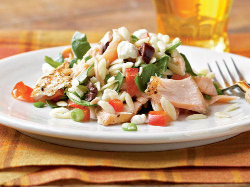 Veggies, salmon, and orzo target healthy food groups in this yummy dinner idea.