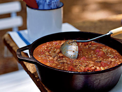This classic, American-style chili hails from the Midwest, in Illinois, where a coarse grind of meat is preferred (though any grind of turkey or sirloin will work for this recipe). It's not about five-alarm heat here, but rather a rich base thanks to a slow-simmered mixture of tomato sauce and beer, as well as earthy, savory flavors from Worcestershire sauce, cumin, and chili powder. Use a darker beer, like an amber or brown ale, for toasted, malty notes in the finished chili. Serve as your go-to game day chili or for sitting around a campfire.