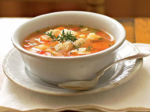 This fish soup features a tomato-and-white-wine base, chopped vegetables, shrimp, scallops, and halibut.  Serve with dry crusty bread for a complete meal.