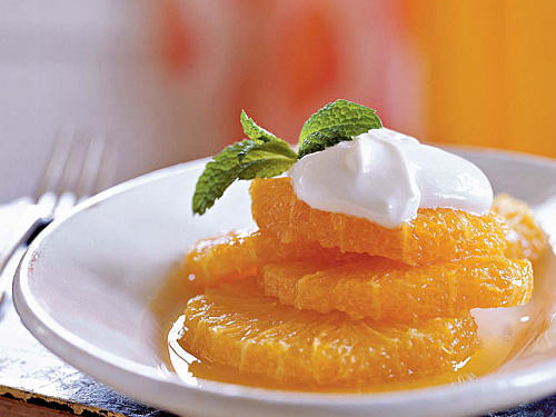For this simple dessert, top tangy-sweet orange slices with homemade caramel-and-cardamom syrup; finish off with a dollop of Greek yogurt flavored with honey and orange-flower water, which can be found in gourmet markets or Middle Eastern grocery stores.