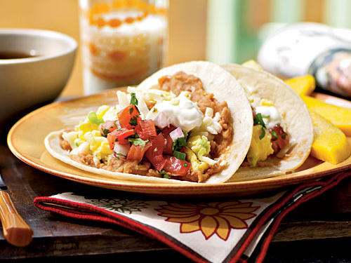 "This recipe isn't just for breakfast. ""My husband & I have this all the time for dinner and we use fresh eggs from a local farm,"" says WadeChartier. ""I substitute flour tortillas and I also triple the amount of cumin. This is a casual night dish."""