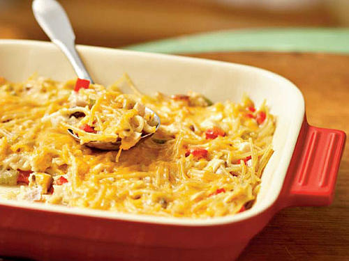 This chicken spaghetti casserole is low in calories and can easily be made ahead of time. The recipe makes two casseroles so enjoy one for dinner and freeze the other for later.