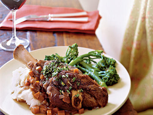 Mint, a favored partner for lamb, fits nicely into the gremolata. Serve these tender shanks with polenta, mashed potatoes, or risotto and broccoli rabe.