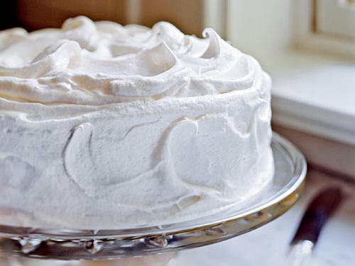 "After a slice of this show-stopping cake, you'll never be able think of vanilla as ""basic"" again. You'll find potato starch on the baking aisle at most of your local supermarkets and health-food stores. Also known as potato flour, it helps ensure the cake will have a fine crumb and moist texture."