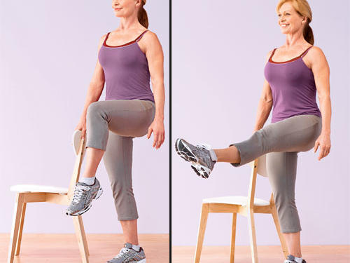 (A) Stand tall and hold the back of a chair with one hand to help maintain balance, if necessary, then lift one knee to hip level. Keep abs pulled in toward spine and back straight. (B) Contract the front of the thigh as you slowly straighten the knee, extending the leg out to the front with toe pointed. Try to keep lifted leg at hip level throughout the move. Bend knee, bringing leg back to bent-knee lifted position. Do not lower foot to the ground until you've completed all reps; switch legs to equal one set.Challenge yourself: Point and flex the foot six to 10 times at the top of each rep to further target the front of your thighs.