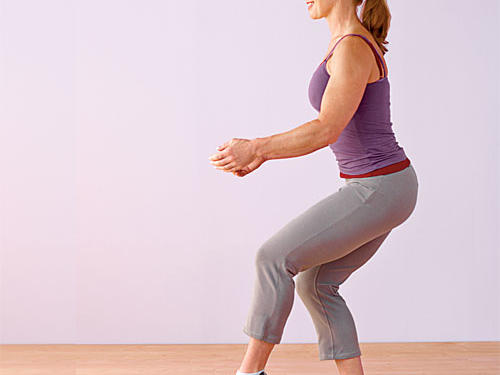 Stand with one foot six to 12 inches in front of the other; shift most of body weight onto back leg. Lightly rest toes of front leg on floor with knee slightly bent. Keep torso steady, and slowly lower into a squat with back leg until thigh is almost parallel to the ground, making sure knee does not extend past toes. Keep only toes of front leg on the floor. Hold for a second or two, then rise back to starting position. Perform all reps before switching legs to equal one set.Challenge yourself: Hold a five- to 10-pound dumbbell in front of body with both hands at hip level, then slightly raise the dumbbell in front of body to chest height as you squat to add resistance and an arm challenge.