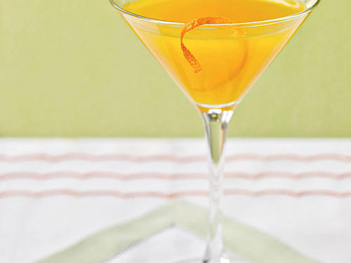 Frozen satsuma sections serve both to decorate the glass and keep the drink chilled.