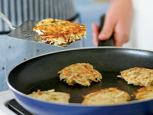 The reserved potato starch helps bind the potato-onion mixture and adds heft to this treat. Use the shredding blade of a food processor for the quickest prep and the fluffiest texture. Thoroughly combine the potato and onion, as the onion helps prevent discoloration. Serve latkes with applesauce and sour cream.
