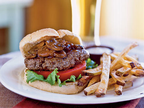 Menu (Time: 55 minutes): Smothered Steak Burgers Shoestring Fries with Garlicky Dijon Mayo Beer or iced teaFast food version (1 burger, 1 small order fries, and 2 ketchup packets): 980 calories, 53 grams fat, 1,950 milligrams sodiumOur version (1 burger, 1 cup fries, and 1 tablespoon sauce): 578 calories, 19.9 grams fat, 980 milligrams sodium
