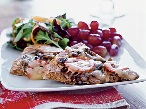 Menu (Time: 42 minutes): Mixed greens salad with toasted pine nuts Double-Mushroom Pizza Red grapesTake-out version (2 slices thin crust): 408 calories, 16.2 grams fat, 1,142 milligrams sodiumOur version (2 slices): 365 calories, 12.3 grams fat, 523 milligrams sodium