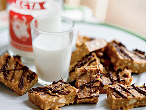 These no-bake bars come together quickly with common pantry ingredients. Make sure the cereal is well crushed (try packing it in a sealed zip-top plastic bag and using a rolling pin) so it incorporates into the peanut butter mixture.